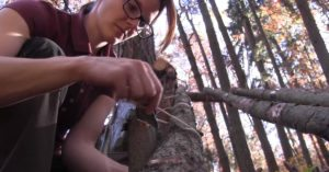 Survivalist builds mini log cabin bug-out camp with her bare hands