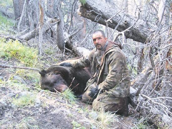 Ron J. Leming with the bear that almost took his life.