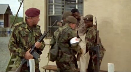 Coetzee walks with his FN FAL 50.00 while Sgt. Jesse Blake (John Kani) carries his own FN FAL in The Wild Geese_imfdb