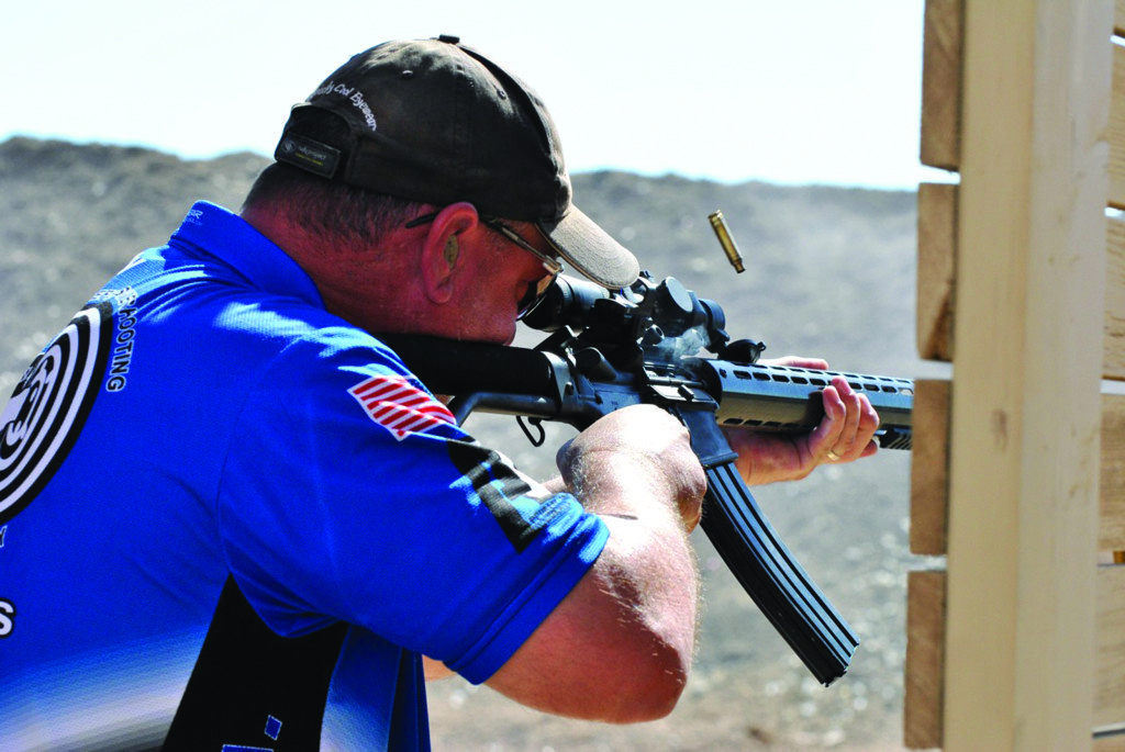 Kelly Raglin competes in Open Division to take advantage of dual optics on his rifle.