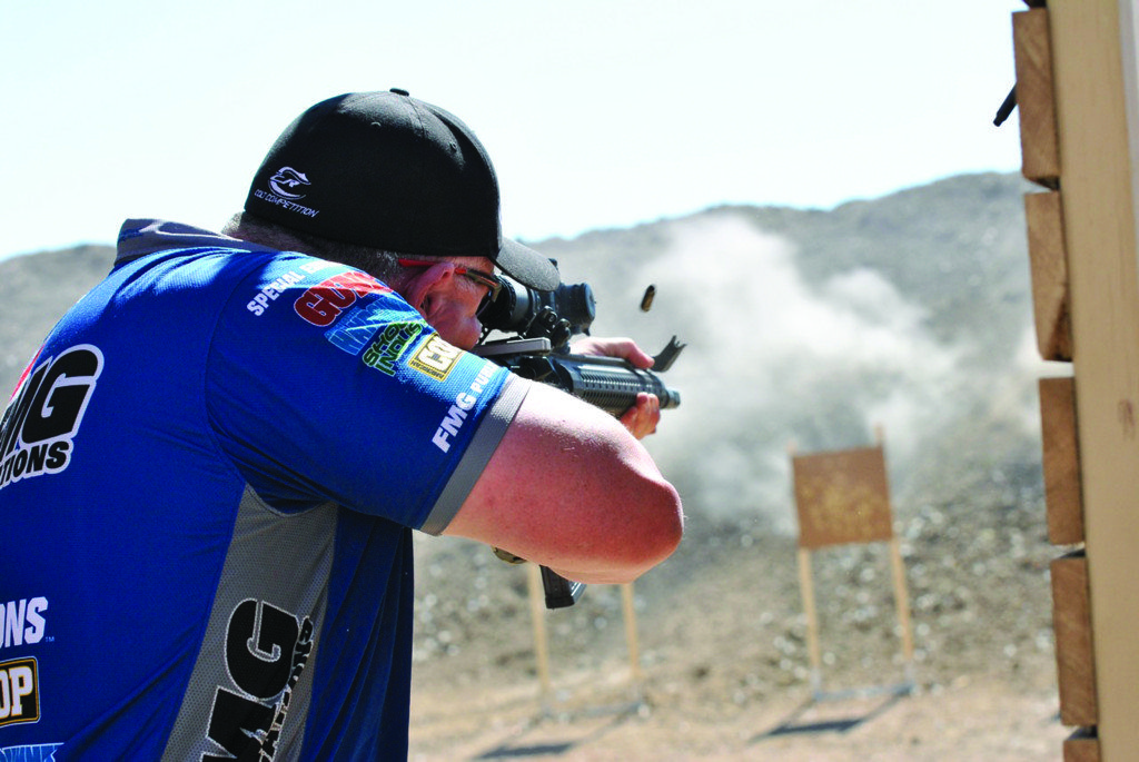 Scott McGregor of FMG Publications competed in TacOps at the 2012 Texas Multigun. (Notice the offset iron sights.)