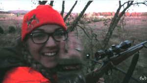 woman bags her first deer with rifle