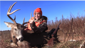 woman shaking with excitement at first deer kill